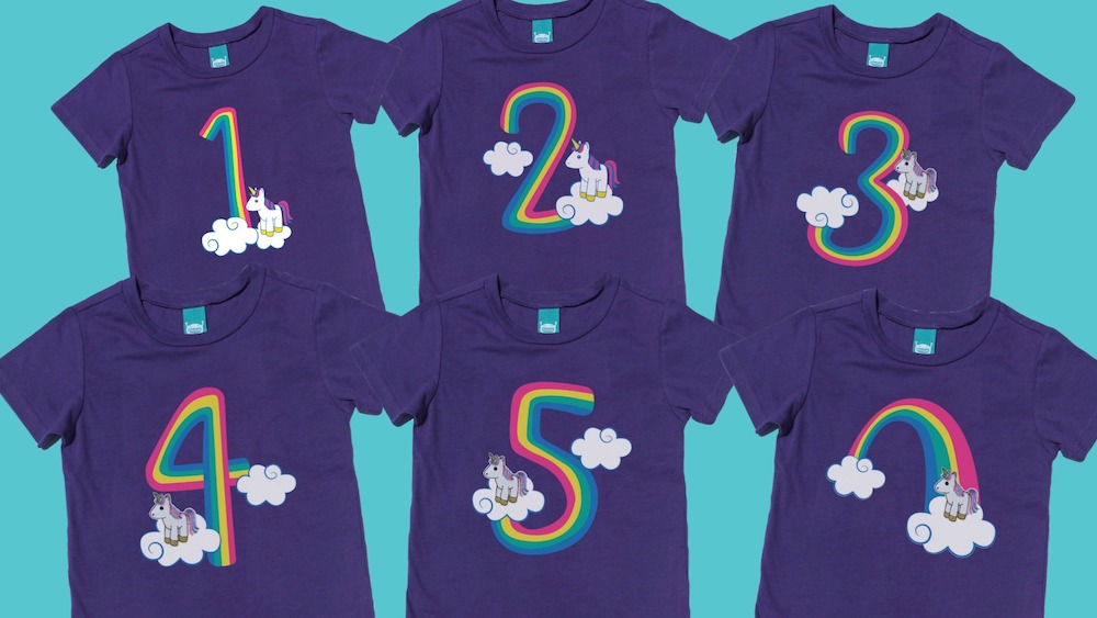These adorable rainbow unicorn shirts have detachable unicorn finger puppets! Available in youth through adult sizes for unicorn lovers of any age! The perfect shirt for a unicorn birthday party. #unicornparty #unicornbirthday #unicornshirt #rainbowunicorn #rainbowbirthday