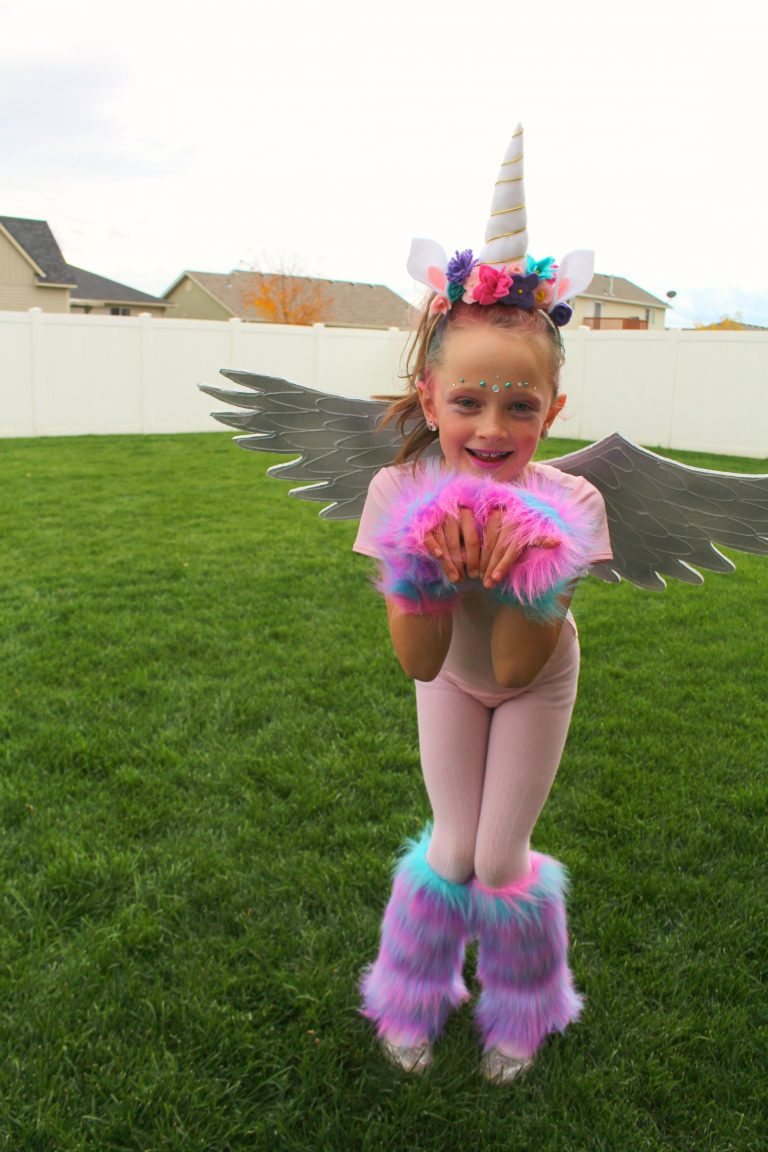 Rainbow pegicorn costume // 11 amazingly bright, bold, and fun rainbow unicorn costume ideas you can DIY or buy #unicorn #rainbowunicorn #unicorncostume #unicornparty #unicornbirthday