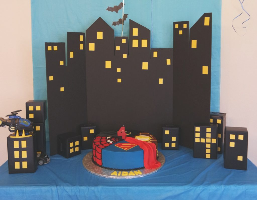 Gotham city cake backdrop // Superhero Birthday Party Ideas - easy and fun superhero games and party decorations you can DIY, from a Gotham City backdrop to Captain America's shield toss #superhero #superherobirthday #superheroparty