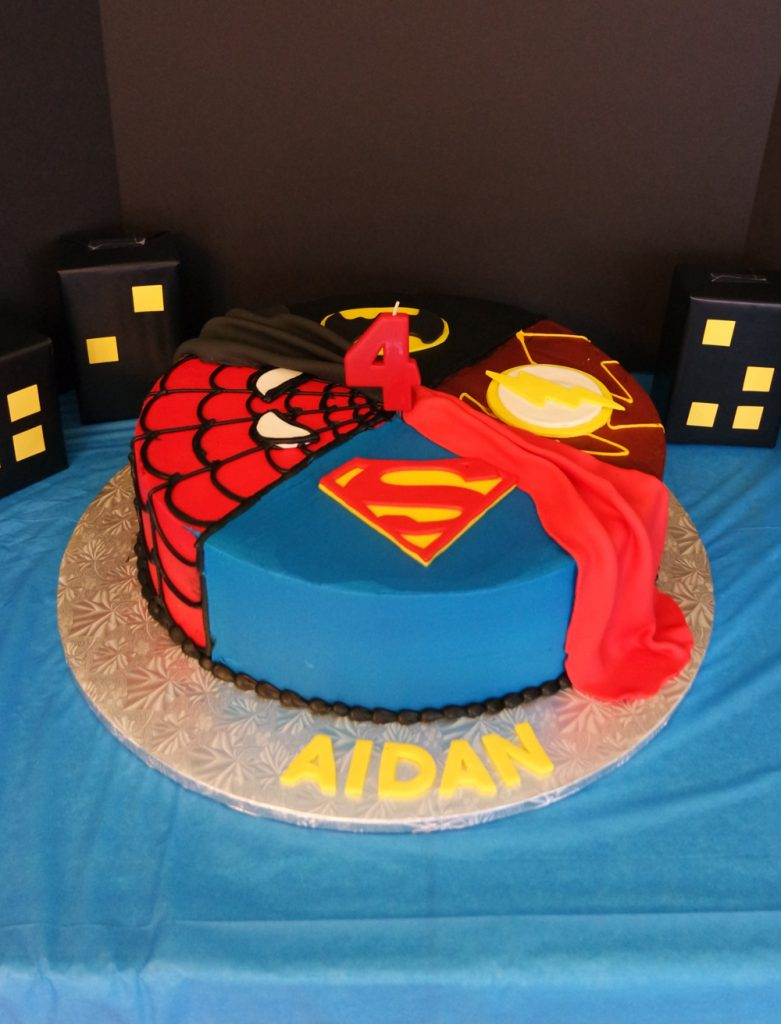 Amazing superhero cake // Superhero Birthday Party Ideas - easy and fun superhero games and party decorations you can DIY, from a Gotham City backdrop to Captain America's shield toss #superhero #superherobirthday #superheroparty