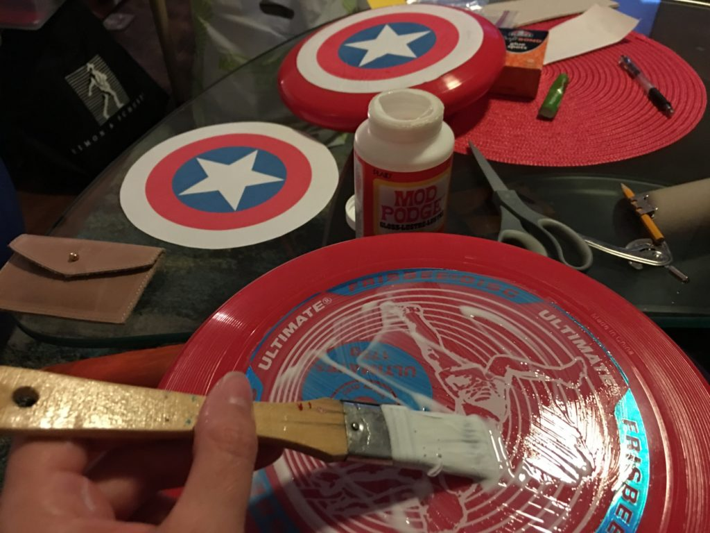 Captain America shields from frisbees // Superhero Birthday Party Ideas - easy and fun superhero games and party decorations you can DIY, from a Gotham City backdrop to Captain America's shield toss #superhero #superherobirthday #superheroparty
