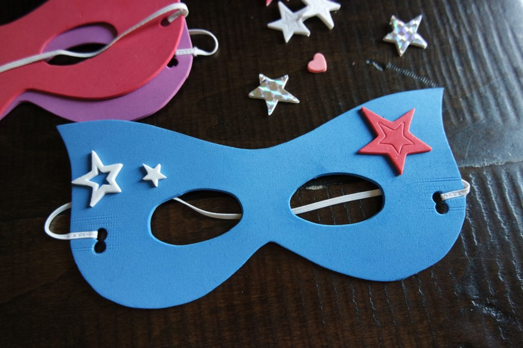 Make your own superhero mask - fun superhero party activity // Superhero Birthday Party Ideas - easy and fun superhero games and party decorations you can DIY, from a Gotham City backdrop to Captain America's shield toss #superhero #superherobirthday #superheroparty