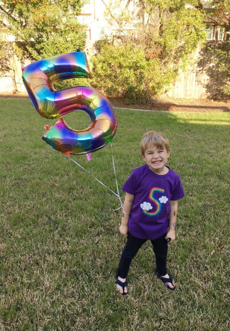Adorable 5 year old birthday shirt. Perfect for a rainbow 5th birthday party, milestone photos, and every day wear. #rainbowunicorn #rainbowbirthday #rainbowshirt