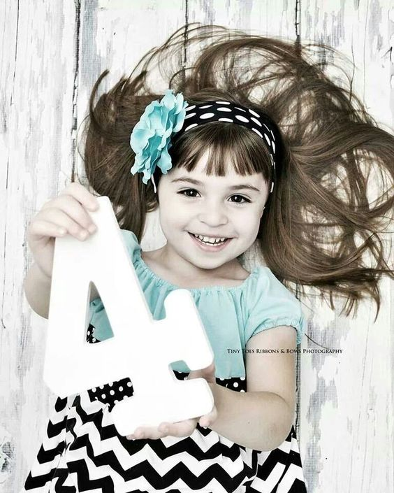 Simple and cute birthday photoshoot ideas for birthday party invitations, photo books, or social media posts. All you need is a cute kid, a cute birthday outfit, and a prop or two!